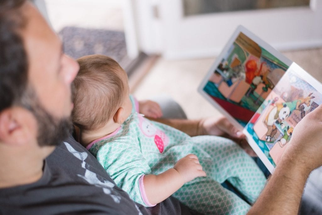 Dad reading a book to toddler